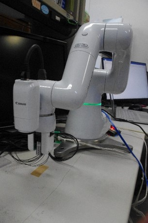 集積化触覚センサと近接センサを取付けた人協調作業可能なロボットアーム